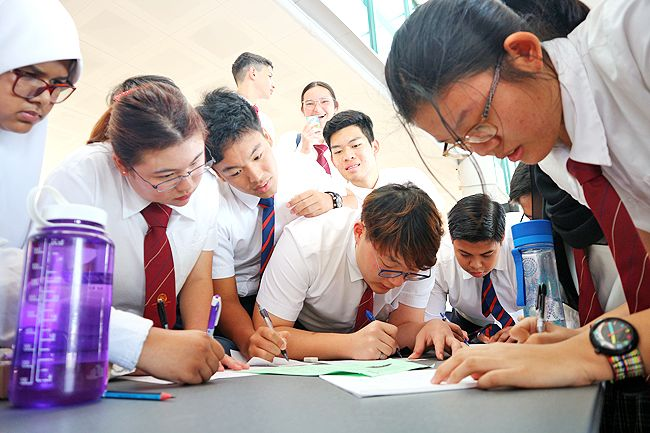 Students of Jerudong International School (JIS) engaging in written activities during their maths week