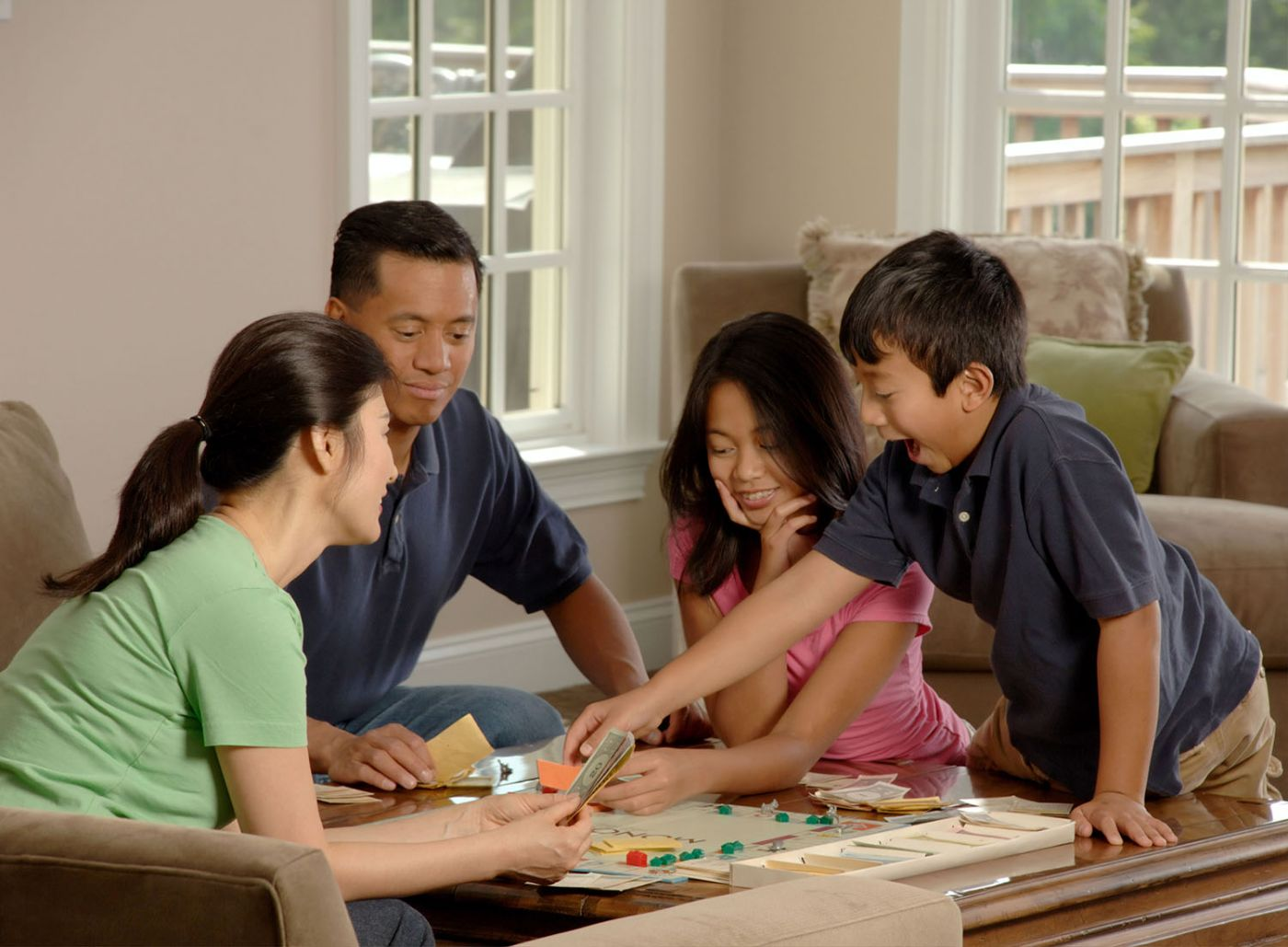 Family playing boardgames together